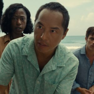 (from left) Mid-Sized Sedan (Aaron Pierre), Patricia (Nikki Amuka-Bird), Jarin (Ken Leung), Guy (Gael García Bernal) and Prisca (Vicky Krieps) in Old, written for the screen and directed by M. Night Shyamalan.