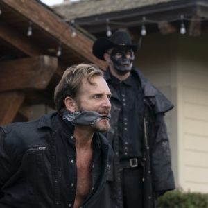 (from left) Dylan Tucker (Josh Lucas) and a Purger in The Forever Purge, directed by Everardo Gout.